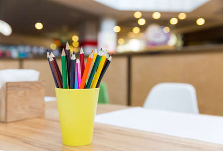 Colorful pencils in yellow glass closeup Stock Photo