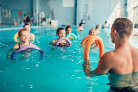 Aqua aerobics, women class with male trainer Stock Photo