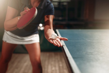 Table tennis, female player with racket and ball Imagens