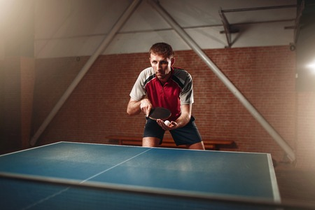 responding: Table tennis, male player with racket and ball