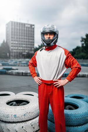 motorizado: Kart driver with helmet in hands, Go-kart
