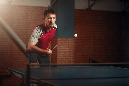 responding: Table tennis, player in action, ball with trace