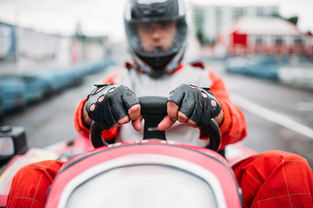 Karting race, go cart driver in helmet Stock Photo