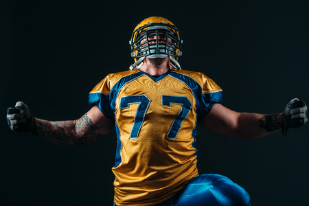 American football player in uniform and helmet Stock Photo