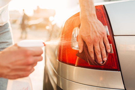 shinning light: Tail lights polishing on car wash station Stock Photo