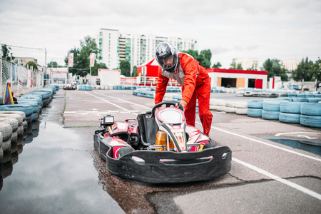 Kart racer on start line, go cart driver Stock Photo