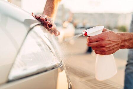 Tail lights polishing on car wash station Stock Photo