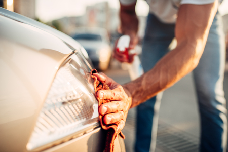 Tail lights polishing on car wash station Stock Photo