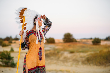 rite: American Indian girl in native costume outdoors Stock Photo