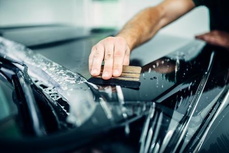 Auto paint protection, transparent film closeup