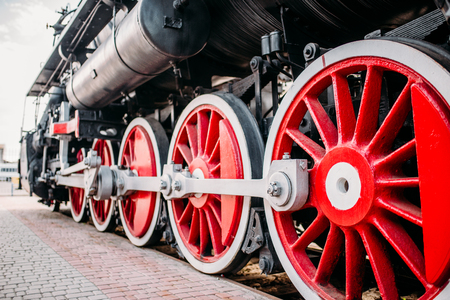 Old steam train, red wheels closeup Stock Photo