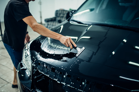 Specialist prepares car for protect against chips 스톡 콘텐츠