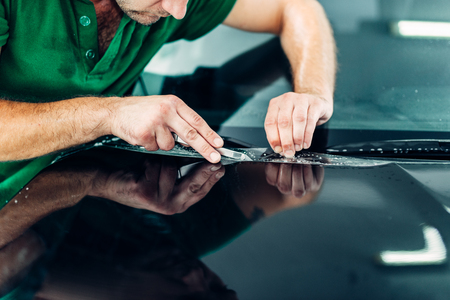 wrappers: Professional worker install paint protect