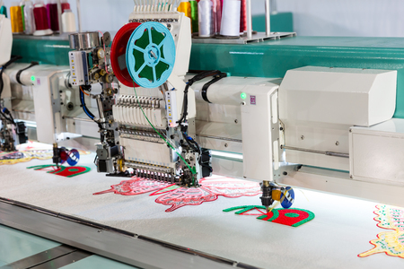 Sewing machine on textile fabric, nobody Stock Photo