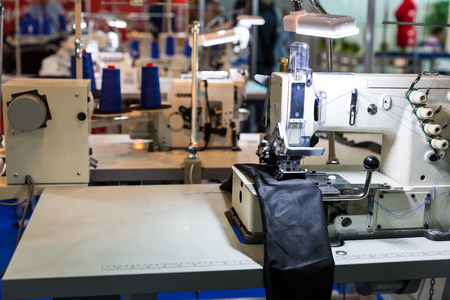 Sewing machine on leather cloth factory, nobody