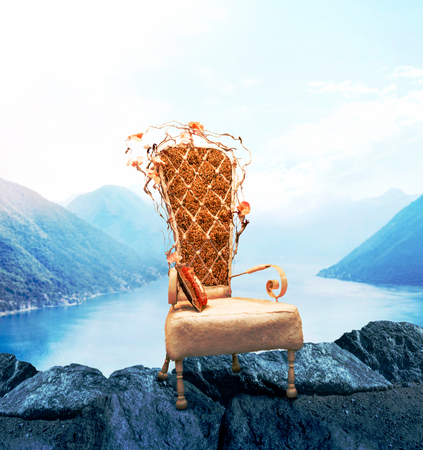 Old chair, mountains and lake on background