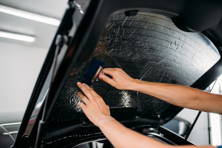 Specialist with drier, tinting film installation Stock Photo