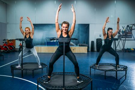Women on trampoline in motion, fitness training