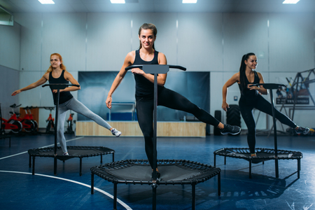 Women group on sport trampoline, fitness workout