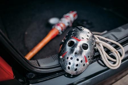 Hockey mask, baseball bat, rope, murderer concept Stock Photo