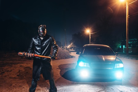 Maniac in hockey mask, baseball bat in hands
