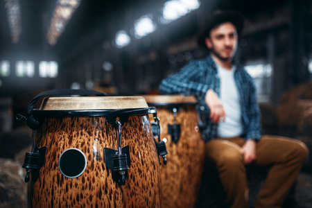 Wooden drums, closeup, male drummer on background Stock Photo