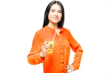 Woman drinks orange juice, white background 版權商用圖片