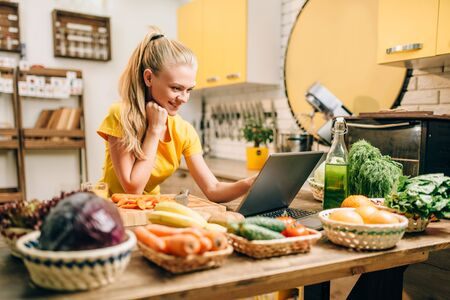 Young woman cooking on recipes, healthy food Stock Photo