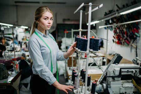 Seamstress create threads on overlock machine