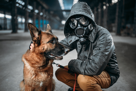 Stalker and dog, survivors in danger zone Stock Photo
