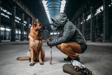 Stalker and dog, survivors in danger zone Stock Photo