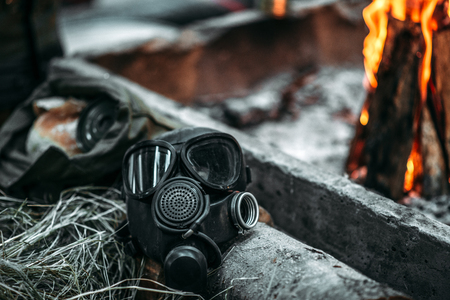 Gas mask against fire, post apocalyptic lifestyle
