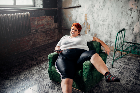 [Image: 94753406-overweight-woman-sits-in-a-chai....jpg?ver=6]