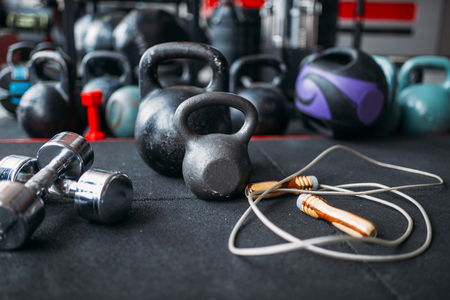 Kettlebells and dumbbells closeup, sport equipment