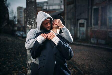 Addict attack his victim on the night street Stok Fotoğraf