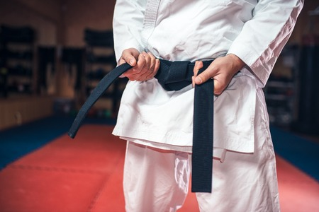 Male person in white kimono with black belt Banque d'images