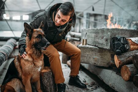 Stalker, post-apocalypse soldier feeding a dog
