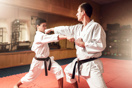 Martial arts masters, self-defence practice in gym Stockfoto