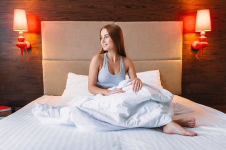 Young woman wake up in the morning, awake Stock Photo