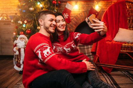 Love couple makes selfie, xmas celebration