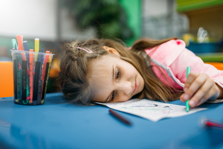 Little girl asleep on playground Stock Photo