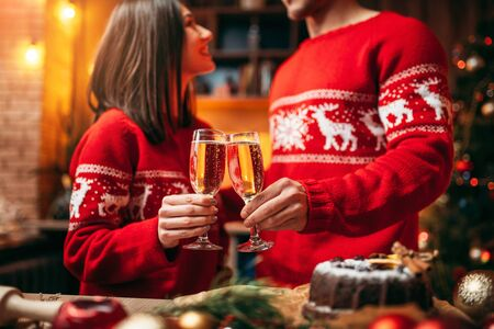 Couple holds glasses with champagne, christmas Stock Photo