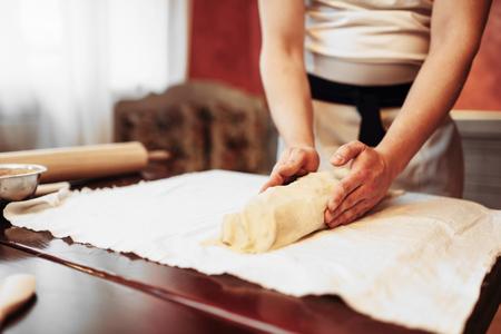 Chef prepares classic apple strudel for baking Stock Photo