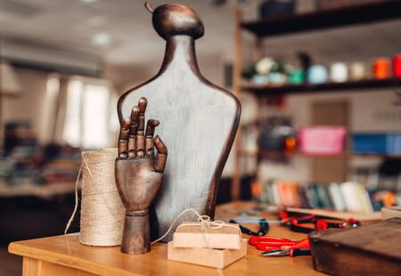Needlework accessories, wooden hand and mannequin Stock Photo
