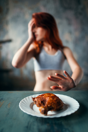Skinny woman refuses to eat, anorexia