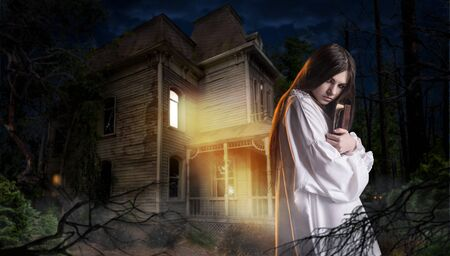 Woman with spellbook, abondoned house in the night