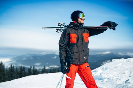 Skier with skis and poles in hands, winter sport Stock Photo