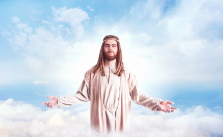 Jesus Christ with open arms against cloudy sky