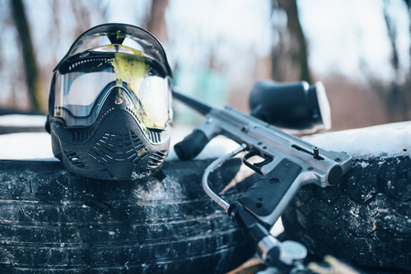 Splattered paintball mask and marker gun