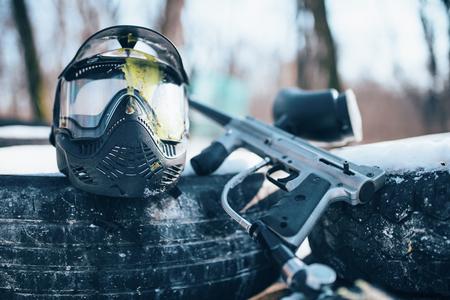 Splattered paintball mask and marker gun